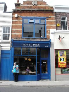 Tea & Times - Welcoming café-cum-newsagent run by the indefatigable Veronica and her family and friends High Street Whitstable Whitstable Kent, Sandwich Bar, Self Catering Cottages, Kent England, Guy Pictures, Places To Eat, Tea Time, Man Picture, Outdoor Decor