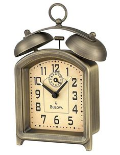 This bedside alarm clock by Bulova features luminous hour and minute indicators on the tips of the hands and a sub-second dial. . . . . Metal case in an antique bronze finish . . Luminous hour and minute hand . . 36 hour key wind (this clock requires...
