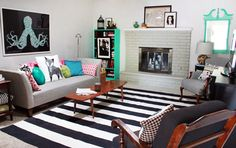Adorable living room. Love the pops of bright turquoise on the shelf and mirror. // A Beautiful Mess