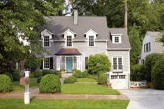 """Sometimes a house muddles through life without living up to its potential. This one-and-a-half-story Atlanta cottage had good bones but needed a face-lift. """"Its scale was really nice, but there were lots of little imperfections,"""" says architect Ross Piper. """"I wanted to make it what it was intended to be, not strip away any of its Cape Cod character."""" First up was correcting the asymmetrical roofline and too-small dormers and entry. Changing the cladding and refining all the details stayed…"""