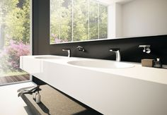 Deck-mounted basin mixer with DuPont™ Corian® handle, Chrome + Deep Nocturne Corian® finishing