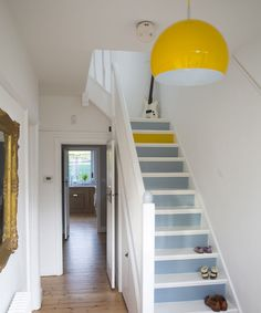 The Best 24 Painted Stairs Ideas for Your New Home White hallway with painted stairs. Yellow lamp and one yellow step, looks nice :)White hallway with painted stairs. Yellow lamp and one yellow step, looks nice :) Yellow Hallway, Hallway Paint, White Hallway, Hallway Colours, Yellow Stairs, Hallway Flooring, Dado Rail Hallway, White Stairs, Hallway Furniture