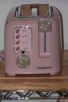 Great idea! anything can be rhinestoned! Must bling up my pink toaster when I have a moment and some superglue