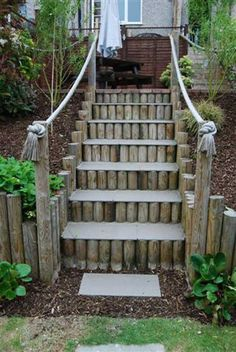 Logs used as a retaining wall, steps and supporting a rope handrail. - The Best 23 DIY Ideas to Make Garden Stairs and Steps