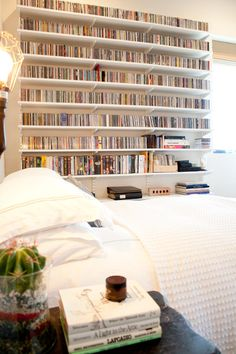 My ideal bedroom would have bookshelves like this.   :)