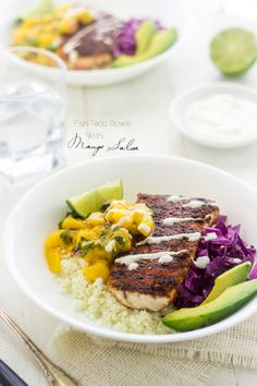 Fish Taco Bowls with Mango Salsa and Cauliflower Rice - a healthy twist on a classic! | Foodfaithfitness.com | #recipe #taco #glutenfree
