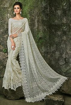 717487: White and Off White color family Bridal Wedding Sarees with matching unstitched blouse.