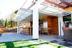 Glass Garage Doors for Patios | Beautiful patio that gets extended thanks to the glass garage doors