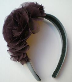 Awesome tutorial on making your own flowers for a headband. If I had more hair, I would def make this!