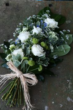 Cream rose and blue thistle sheaf funeral tribute - an elegant combination for a Scottish gentleman