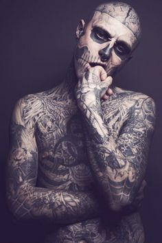 Rick Genest. i'm not sure if the face is tattoed or great paint job !