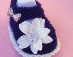 exclusive cutie booties!!  perfect for christening accessory, baby shower, photo prop, newborn or reborn doll, baby gift  baby girls hand knitted mary jane booties knitted inpure white 8-ply yarn with strawberry pink trim around sole  beautiful pastel eyelet lace knitted into the front of the booties and astrawberry pinksatin rosebud sewn into the centre of the lace  pink flowerbutton closure  sole measures8 - 8.5 cms  international shipping $4  PLEASE VIEW MY OTHER LISTINGS AND SEE…