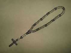 Paracord beads rosary with Celtic cross.
