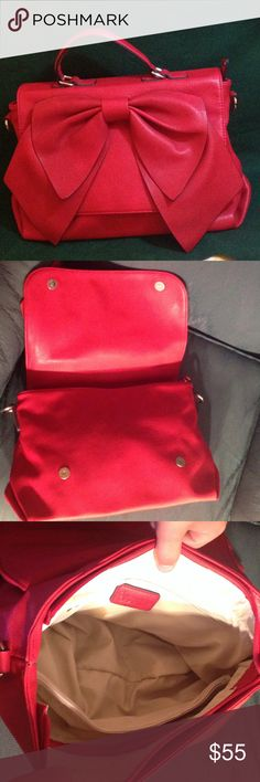 ❤!!️RESERVED!!❤️NWOT Charming Charlie Satchel Bag RESERVEDChristmas in July! Never used NWOT satchel bag. Adjustable strap never attached, comes too! Pretty bow on the front, opens and closes with magnetic buttons. Gold toned hardware. Two zipper compartments and two slip pockets inside. Reasonable offers considered! Charming Charlie Bags Satchels