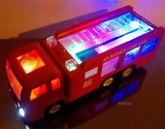 "WolVol Electric Fire Truck Toy with Stunning Lights and Sirens (""fire alarm, lets go"", ""out of my way"".), goes around and changes directions on contact - Great Gift Toys for Kids - Toys 4 My Kids"