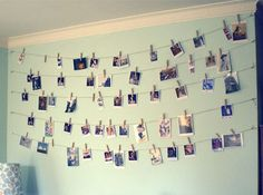 Create wall art with twine and a few clothes pins. What a great and cheap way to display my favorite pictures