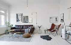 The nice things about light wood or white floors in a home is that everything you add on top of it stands out. I like how in the home the leather couch and butterfly chair really jump out of the … Continue reading → My Living Room, Home And Living, Living Room Inspiration, Interior Inspiration, Scandinavian Interior Design, Leather Sofa, Cheap Home Decor, Room Interior, Home Remodeling