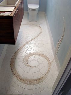 I really dig this mosaic floor by godutchbaby, the wall accent is a great idea; the effect is there but doesn't involve doing the rest of the walls to match.