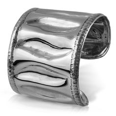 From the Alpaca Collection  The flowering poinciana tree is a showstopper, but the long, flat tree pods are what spoke to us. With luxurious smooth ridges and beautifully finessed details, this cuff makes an organic statement of class and sophistication....
