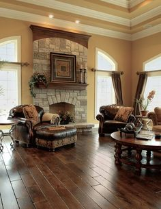 Nice look. Best 10 Stunning Tuscan Living Room Designs : Astonishing Beige Tuscan Style Living Room Design with Wonderful Wooden Round Coffee Table and Brown Leather Sofa also Nature Stone Frame Fireplace Tuscan Living Rooms, Home Living Room, Living Room Designs, Living Room Decor, Dining Rooms, Living Area, Design Toscano, Tuscan House, Tuscan Decorating