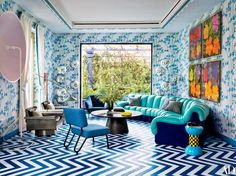 With turquoise walls and sapphire-striped floors, the provocative Milan penthouse of Fiat heir and globe-trotting entrepreneur Lapo Elkann showcases his singular style and pays tribute to his favorite hue
