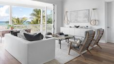 This Breezy Bahamian Retreat Proves Sleek and Simple Is the Ultimate Beach House Bliss   With accordion doors that open up completely to the terrace, the living area is a true indoor-outdoor escape. To further blur the lines, the designers opted for earthy textures inside, including unglazed ceramics, live-edge wood, limestone tables, and rope detailing.  #beachhouse #beachdecor #thebahamas #coastalliving