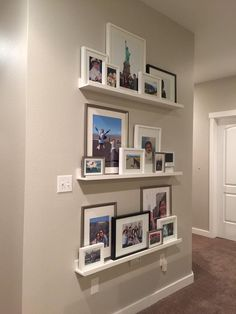 OUR GALLERY WALL - we topped the top of the stairs with a gallery wall of various portraits and vacation photos in a variety of frame sizes, colors and textures