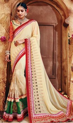 Re ameliorate your beauty dressed in this beige and green color georgette net embroidered sari. The fantastic saree creates a dramatic canvas with terrific lace, resham and stones work.  #traditionalsaris #trendydesignsarees #gorgeouslooksaree