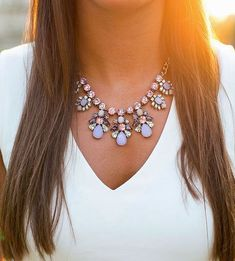 When a top or dress has a V-neckline, try throwing on a statement necklace, especially one with a tiered structure that follows the shape of the shirt! http://www.bhg.com/beauty-fashion/fashion/statement-necklaces/?socsrc=bhgpin110814wearwithvnecks&page=2