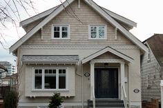 Combination of cedar shingle and heavy dash stucco give this heritage style house a classic look. Cedar Shingles, Old Houses, House Exterior, Stucco Homes, Blue House, House, Window Trim Exterior, Window Trim, Shingle House