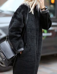 Stay warm this winter with a black faux fur coat