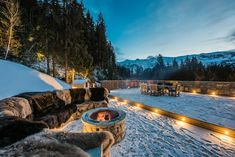 Outside on the spacious terrace there is a fire pit, perfect for enjoying toasted marshmallows and mugs of hot chocolate after skiing. In the warmer, spring months watch the sunset in the early evening with a glass of champagne.