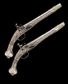 A PAIR OF 20 BORE OTTOMAN BALKAN SILVER-GILT MOUNTED FLINTLOCK HOLSTER (KUBUR) PISTOLS, LATE 18TH/EARLY 19TH CENTURY, PROBABLY GREEK.