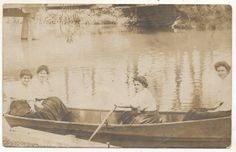 Girls in a canoe at Williams Grove Park. Back reads Williams Grove July 14, 1908.