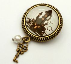 This cute brooch is a beautiful accessory for the next Halloween party. It consists of a bronze jewelry setting made of metal with a handmade glass cabochon, showing a scene with haunted house and bats. The special highlight is the shell pearl that I have attached to the lower eye, along with a key charm.Including the pendant the brooch has the dimensions 5.3 x 2.3 L B cm.The brooch comes in an organza bag to you; ideal for storage and further giving.Goods will be shipped immediately after…