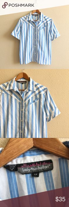 '70s / Lady Manhattan Blouse Short sleeve button down blouse. Blue and white stripes, western style seams and diagonal pocket on front.  BRAND: Lady Manhattan MATERIAL: poly / cotton blend YEAR/ERA: late 70s / early 80s LABEL SIZE: 12 BEST FIT: S/M  MEASUREMENTS: Chest 21.5 inches  Length 24 inches  → Style inspiration: Jane Birkin, 1978 ☒ I do not model or trade, sorry! ❁ Check out my closet for more vintage! Vintage Tops Button Down Shirts
