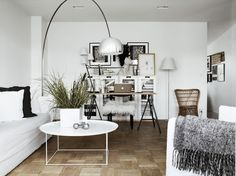 White walls, gallery frame wall, gorgeous lights and timber floors.
