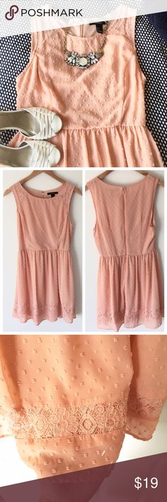 """sherbet sleeveless dress. The cutest mini dress from Forever 21.  Gorgeous clip dot fabric in soft peach tone.  Lace accents on hem and shoulders.  Dyed to match under slip in peach color.  Dyed to match back zipper opening.  Worn once to a wedding, perfect condition!  Approximately 32"""" from shoulder to hem.  Size small. Forever 21 Dresses Mini"""