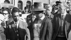 In Mandela was sentenced to life imprisonment for plotting to overthrow South Africas apartheid regime. Here, his wife, Winnie, leaves the courtroom after the verdict. Winnie Mandela, First Year Of Marriage, Solitary Confinement, The Verdict, Apartheid, First Job, Black Image, Nelson Mandela, 40 Years Old