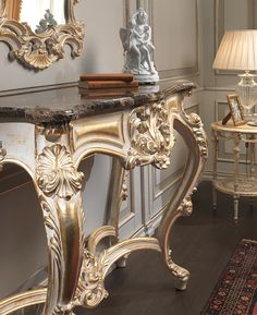 Carved console with Emperador marble top and carved mirrror, all finishing white…