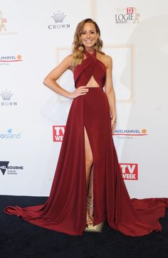 A cut above the rest! The Project's Carrie Bickmore shows off STUNNING figure and midriff in burgundy gown on the Logies red carpet Infinity Dress Bridesmaid, Long Bridesmaid Dresses, Prom Dresses, Formal Dresses, Burgundy Gown, Revealing Dresses, Blush Gown, Convertible Dress, Red Carpet Fashion