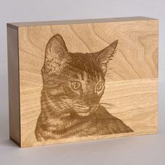 Small Saints custom laser- engraved portrait urn made by Small Saints.  Made from Canadian western red birch, this quality urn is beautiful to look at, is discreet with a removable back, and hangs on your wall