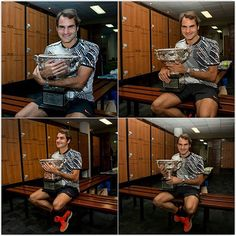 #Federer poses in the locker room with the Norman Brookes Challenge Cup after winning the #AusOpen [Fiona Hamilton-Pool/Getty]