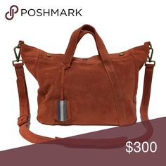 """❤️ Madewell Suede Stockholm Satchel in Rust Perfect as a handbag, crossbody, or over your shoulder. Three magnets keep this cute, slouchy satchel closed, while still giving you easy access. This gorgeous red-brown rust color is stunning. This bag has minimal signs of wear, shown in the pictures. This bag is one of a kind in suede inside and out and in this color. It was a sample bag for Madewell's designers and was never produced in all suede or in this color.  Approximately 11""""h x 17""""w x…"""