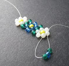 Inspirational Beading: Beading Tutorial: Potawatomi Daisy Chain ~one of the first things i learned as a childYou'll see that once the first flower you stitch is complete, all of the steps…This week we talked a bit about beading origins , and the cu Seed Bead Jewelry, Beaded Jewelry, Handmade Jewelry, Beaded Bracelets, Handmade Wire, Seed Beads, Peyote Bracelet, Bead Earrings, Jewelry Findings