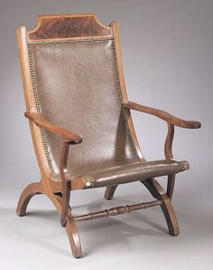 """A Late Classical Carved Mahogany """"Campeachy"""" Chair, c. 1840."""