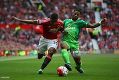 Jeremain Lens of Sunderland and Antonio Valencia of Manchester United compete for the ball