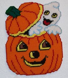 Items similar to 1733 Ghost in Pumpkin Wall Hanging on Etsy Plastic Canvas Ornaments, Plastic Canvas Tissue Boxes, Plastic Canvas Crafts, Plastic Canvas Stitches, Plastic Canvas Patterns, Halloween Canvas, Happy Halloween, Perler Bead Emoji, Perler Beads