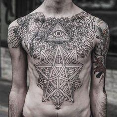 Amazing #chestpiece #tattoo - geometric design including #theallseeingeye…