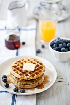 Gluten Free Blueberry Waffles: 1 3/4 cups warm water  1/2 cup finely ground flaxseed  1/2 cup potato flour  2 cups superfine rice flour  2 teaspoons baking powder  1 teaspoon baking soda  pinch salt  1 3/4 cups coconut milk  2 tablespoons honey  1 cup fresh blueberries  syrup
